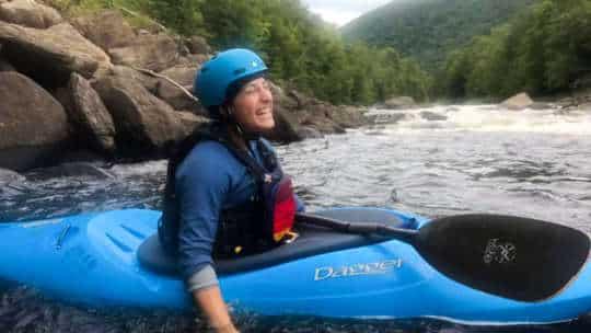 Amanda Major in a kayak on a river