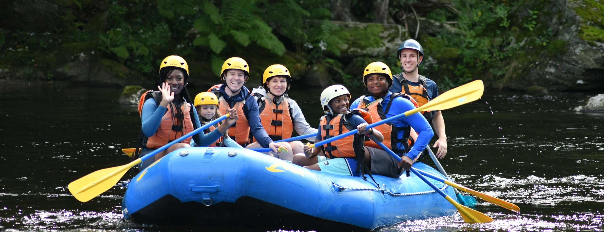 A family floating down the river in a raft having a nice time