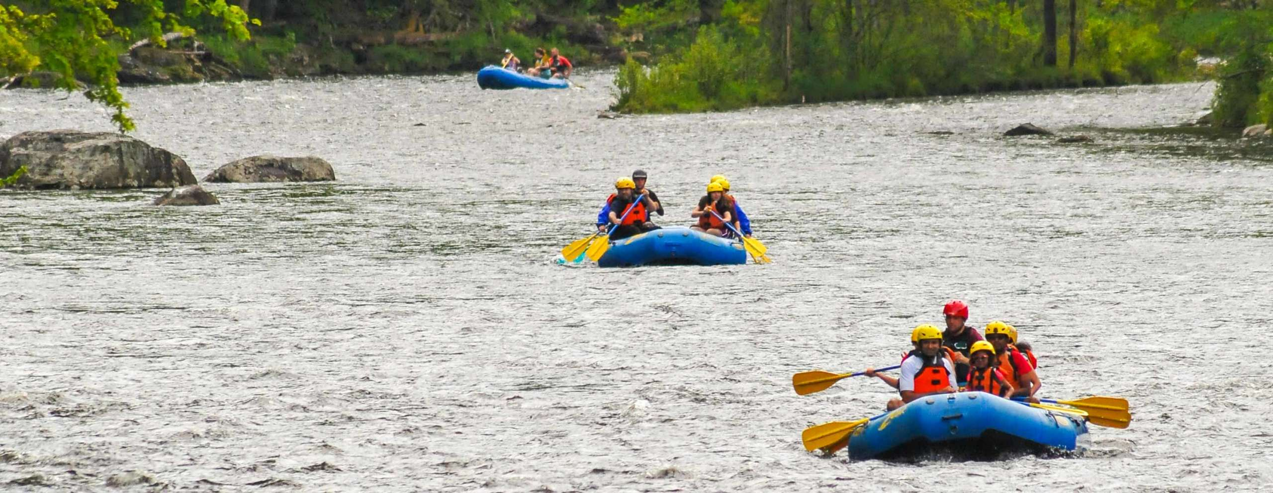 Families in rafts floating down a river
