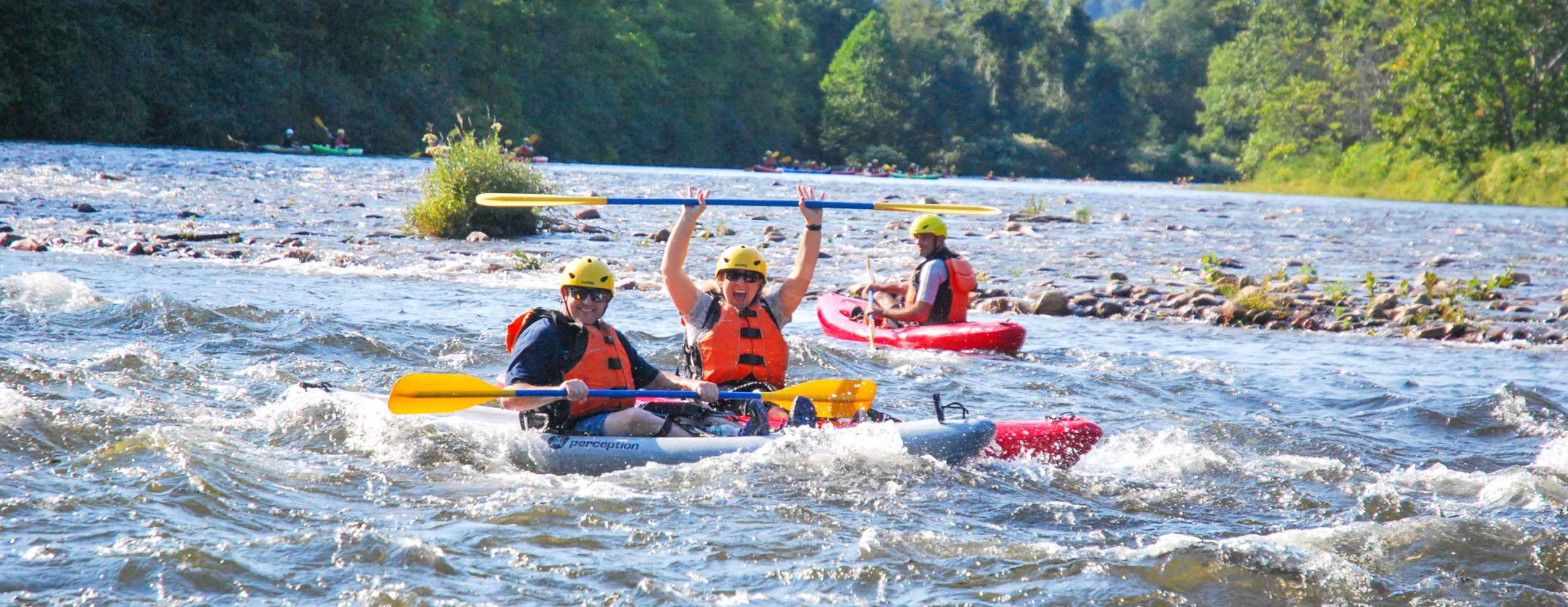 Group of kayakers on the river having fun