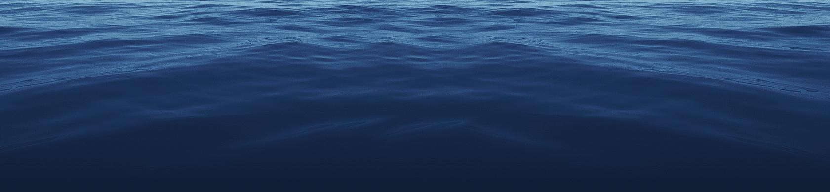 Calm dark blue water