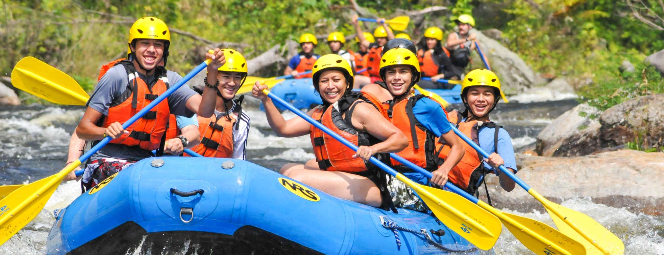 Group of rafters having fun navigating rapids