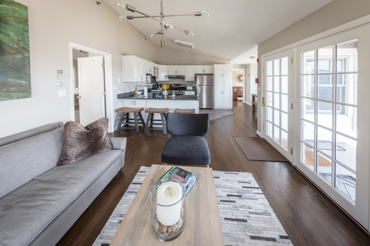 Living room kitchen open concept with french doors