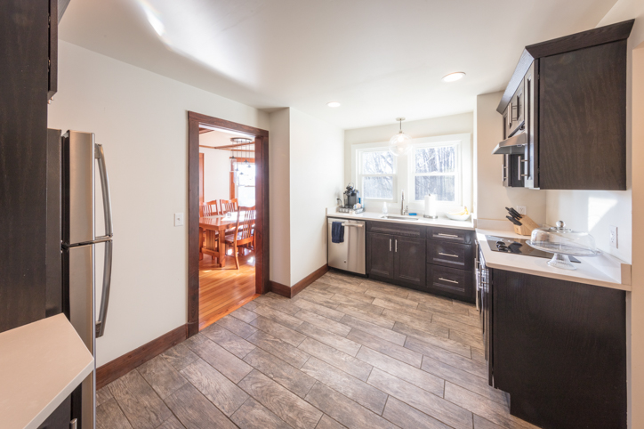 Bright open kitchen with granite countertops and upgraded appliances