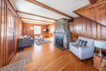 Large living room with wood floors and fireplace