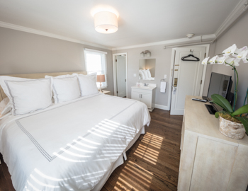 Bright light bedroom with queen bed