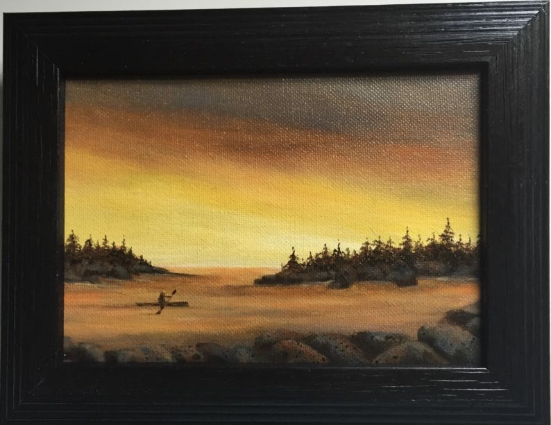 a framed painting of a kayaker in the water at sunset