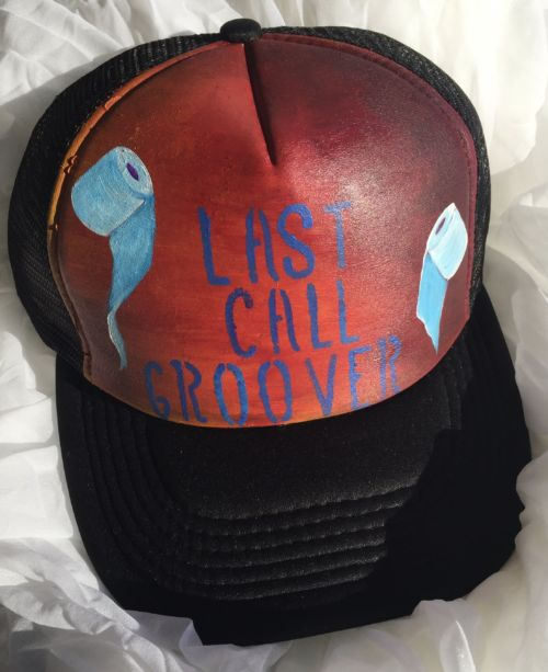 A trucker hat with the words Last Call Groover and toilet paper rolls on it