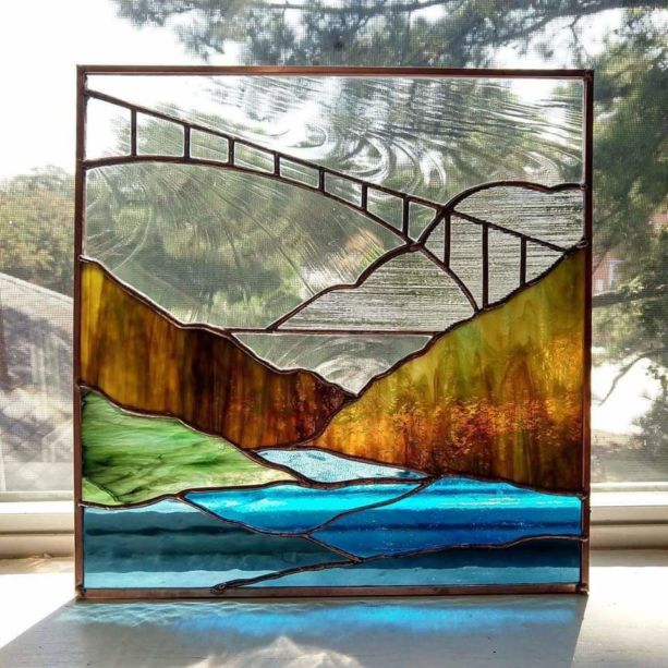A stained glass image of a river gorge