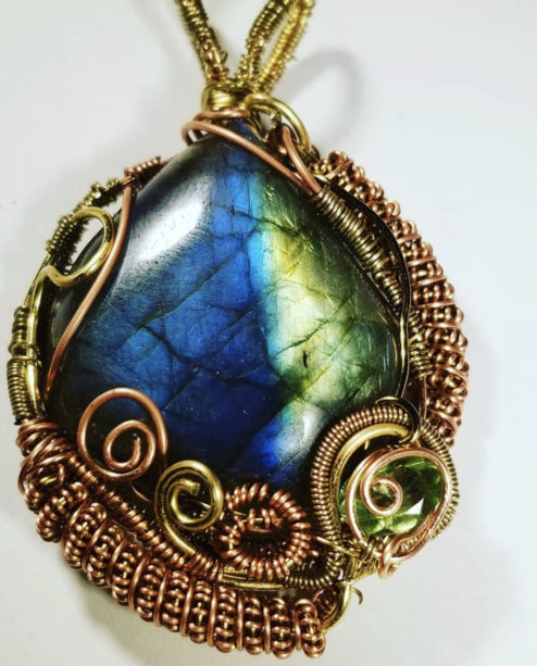 a blue green necklace